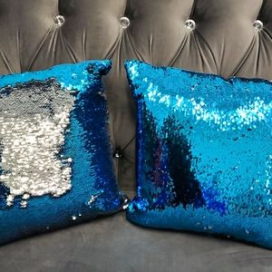A pair of blue silver sequin cushion
